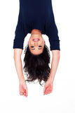 Woman upside down. Pretty young woman upside down portrait on white Royalty Free Stock Image