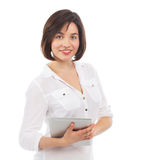 Pretty young woman using an electronic tablet Royalty Free Stock Photos