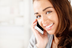 Pretty young woman using mobile phone Stock Photos