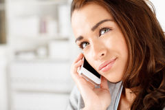 Pretty young woman using mobile phone Royalty Free Stock Photos