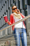 Pretty young woman using mobile phone in the city Royalty Free Stock Photos