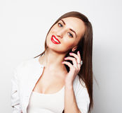 Pretty young woman using mobile phone Stock Images