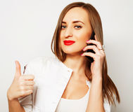 Pretty young woman using mobile phone Royalty Free Stock Images