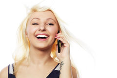 Pretty young woman using mobile phone Stock Photo