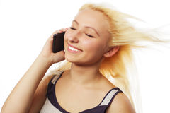Pretty young woman using mobile phone Royalty Free Stock Photo