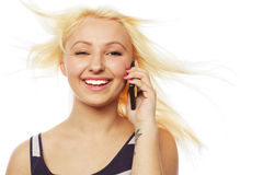 Pretty young woman using mobile phone Royalty Free Stock Photography