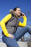 Pretty young woman using smart phone Stock Photo
