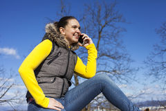 Pretty young woman using smart phone Stock Image