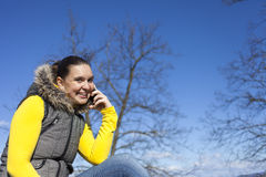 Pretty young woman using smart phone Royalty Free Stock Images