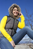 Pretty young woman using smart phone Stock Photography