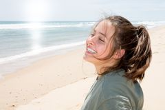 Pretty young woman on vacation beach summer sunny day sea. Happy cute pretty young woman on vacation beach summer sunny day sea Stock Photography