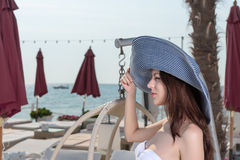 Pretty young woman vacationing at a seaside resort Stock Photography
