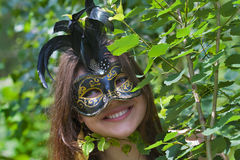Pretty young woman with venetian carnival mask Royalty Free Stock Photo