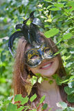 Pretty young woman with venetian carnival mask Royalty Free Stock Photos
