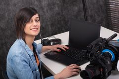 Young woman video editor working in studio stock photos