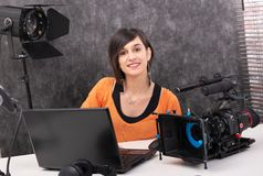 Young woman video editor working in studio royalty free stock image