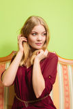 Pretty young woman on vintage sofa. Fashion. Royalty Free Stock Photography