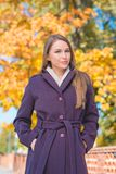 Pretty Young Woman in Violet Coat During Autumn Stock Image