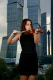Pretty young woman with violin Stock Image