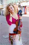 Pretty young woman with violin Stock Photos