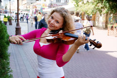 Pretty young woman with violin Royalty Free Stock Photo