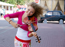 Pretty young woman with violin Royalty Free Stock Photos