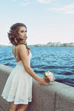 Pretty young woman waiting  on Promenade Stock Images