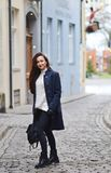 Pretty Young Woman Walking in City Autumn Relax Coat. Pretty Beautiful Young Woman Walking in Autumn City Relax Coat City Long Hair Make up White Sweater Royalty Free Stock Image