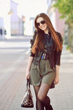 Pretty young woman walking on the street Stock Photo