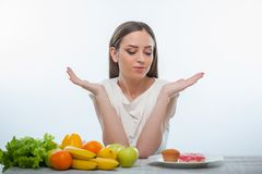 Pretty young woman wants to eat sweet food Royalty Free Stock Images