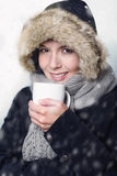 Pretty young woman in warm winter fashion Royalty Free Stock Photo