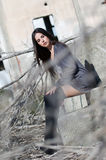 Pretty young woman wear high black socks and long shirt royalty free stock images
