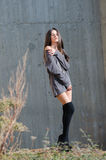 Pretty young woman wear high black socks and long shirt Stock Images