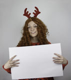 Pretty young woman wearing antlers and holding blank sign Stock Image