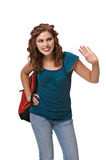Pretty young woman wearing backpack. Isolated against white background Stock Photo
