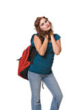 Pretty young woman wearing backpack. Isolated against white background royalty free stock photos