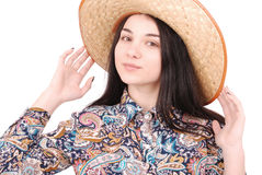 Pretty young woman wearing a big floppy straw sun hat. Isolated on white Royalty Free Stock Images