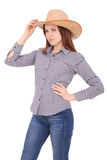 Pretty young woman wearing a big floppy straw sun hat Stock Image