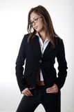 Pretty young woman wearing business suit stock photos