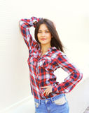 Pretty young woman wearing a checkered shirt Stock Images