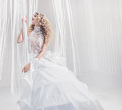 Pretty young woman wearing elegant gown Royalty Free Stock Image