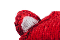 Pretty young woman wearing a hand knitted red hat on white background. Isolated. Beautiful girl in with Ear flap. Royalty Free Stock Images