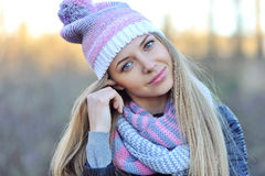 Pretty young woman wearing hat and scarf. Close up Stock Images