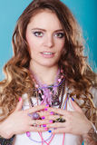 Pretty young woman wearing jewelry necklaces rings. Pretty young woman wearing many plenty of jewelry necklaces beads and rings. Portrait of gorgeous fashion Royalty Free Stock Image