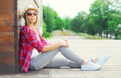 Pretty young woman wearing a pink shirt and summer hat Stock Images