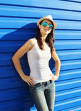 Pretty young woman wearing straw hat and sunglasses Stock Photo