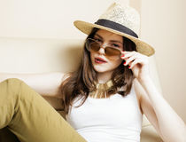 Pretty young woman wearing sunglasses and summer hat, fashion people concept hipster Stock Photos