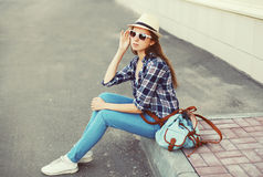Pretty young woman wearing a sunglasses, summer straw hat Stock Image