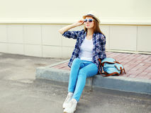 Pretty young woman wearing a sunglasses summer straw hat and checkered shirt with backpack Royalty Free Stock Image
