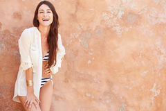 Pretty Young Woman Wearing Swimsuit Leaning Against Wall Stock Photos